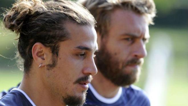 Osvaldo y De Rossi en Italia.