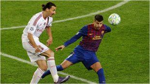 Ibrahimovic y Piqué, durante un Barcelona-Milan.
