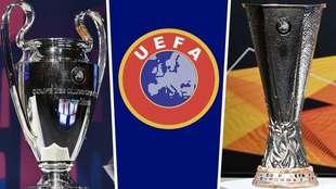 Los trofeos de campeón de la Champions y la Europa League.