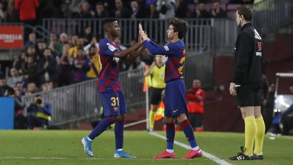Ansu Fati y Riqui Puig, en un partido del Barcelona.