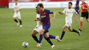 Rakitic, en una acción del partido ante el Sevilla