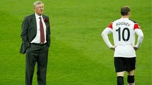 Alex Ferguson y Wayne Rooney, al término de la final de Champions...