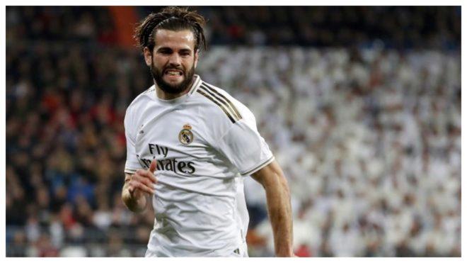 Nacho gesticula durante un partido con el Real Madrid.