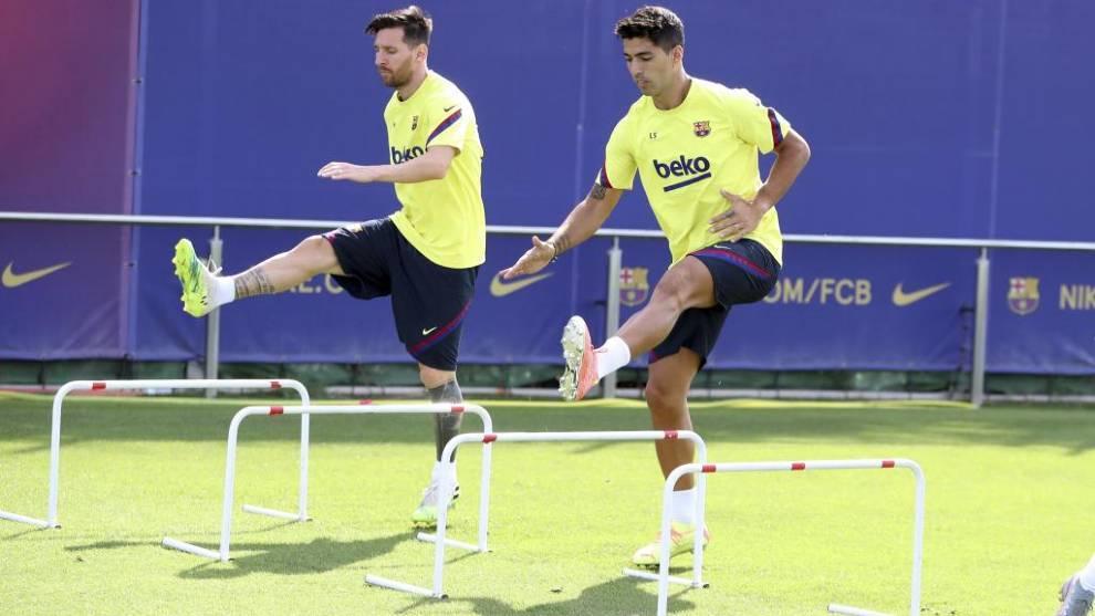 Messi junto a Suárez en un entrenamiento del Barcelona