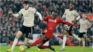 Una imagen de un enfrentamiento entre Manchester United y Liverpool.