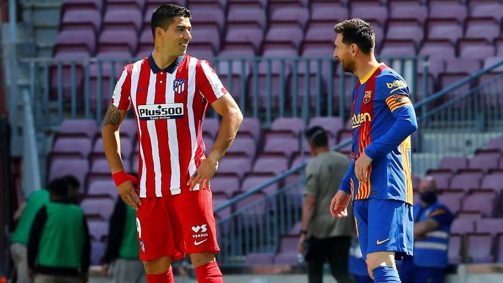 Luis Suárez y Leo Messi, en el último duelo entre Atlético de...